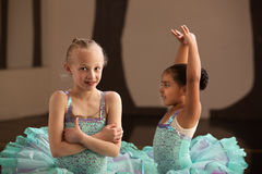 Pretty Young Ballet Students. Pretty little ballet students in performance dresses Stock Image