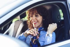 Pretty young woman driving with seat belt is the correct way to drive a vehicle. Pretty young beautiful woman driving with seat belt is the correct way to drive royalty free stock image