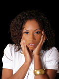 Pretty young black woman with hands along face Stock Image