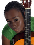 Pretty young black woman holding accustical guitar Royalty Free Stock Photo