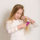 Pretty Young Blond Girl Brushing Her Hair Stock Photography