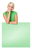 Pretty young blond girl with green copy space. Royalty Free Stock Image