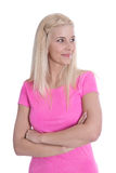 Pretty young blond girl in pink shirt isolated. Royalty Free Stock Photography