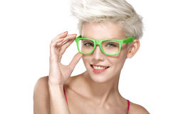 Pretty young blond model wearing cool eyeglasses Stock Photos