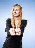 Pretty young blond showing big thumbs up. Stock Image