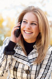 Pretty Young Blond Woman on Phone Outside Royalty Free Stock Images