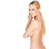 Pretty young blond woman posing topless Stock Images
