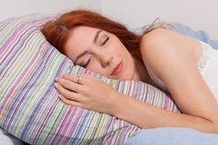 Pretty Young Blond Woman Sleeping on her Bed Royalty Free Stock Photos