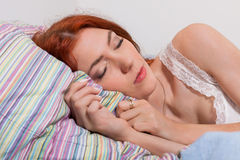 Pretty Young Blond Woman Sleeping on her Bed Royalty Free Stock Photography