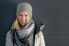 Pretty young blond woman in trendy winter outfit Stock Photography