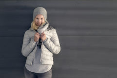 Pretty young blond woman in trendy winter outfit stock photos