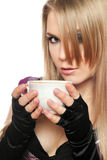 Pretty young blonde with a cup of tea Stock Image