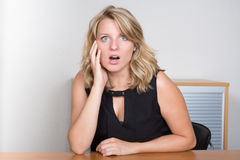 Pretty young blonde feeling surprised Stock Photo