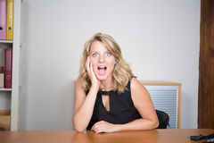 Pretty young blonde feeling surprised Royalty Free Stock Photography