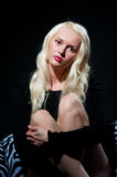 Pretty young blonde female in black Stock Photos