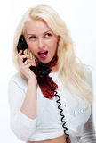 Pretty young blonde female on old phone Royalty Free Stock Images