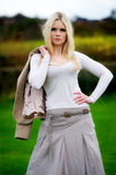 Pretty young blonde female posing outdoors Royalty Free Stock Images