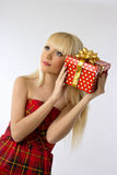 Pretty young blonde girl holding christmas gift Stock Photography