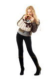 Pretty young blonde with a handbag. Isolated Royalty Free Stock Photo