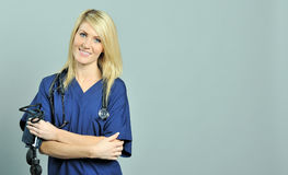 Pretty young blonde healthcare professional Stock Image