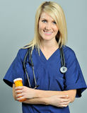 Pretty young blonde healthcare professional pills Royalty Free Stock Images