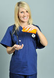 Pretty young blonde healthcare professional pills Stock Photography