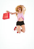Pretty young blonde holding shopping bags Royalty Free Stock Image
