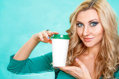 Pretty young blonde holding a white paper cup Stock Image