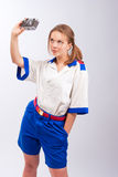 Pretty young blonde sailor with camera Stock Images
