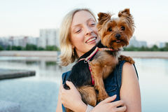 Pretty young blonde with small dog Stock Photography