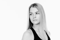 Pretty young blonde sporty woman looking back. Black and white p Royalty Free Stock Photos