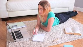 Pretty young blonde studying on her laptop Royalty Free Stock Photo