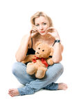 Pretty young blonde with a teddy bear Royalty Free Stock Photo