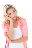 Pretty young blonde thinking with hand on head Stock Image