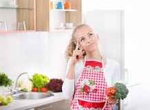 Woman with vegetales in kitchen Stock Image