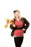 Pretty young blonde woman with plastic flowers Stock Images