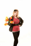 Pretty young blonde woman with plastic flowers Stock Photo