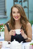 Pretty young blonde woman sitting in the cafe Royalty Free Stock Photo