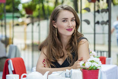 Pretty young blonde woman sitting in the cafe Royalty Free Stock Images