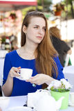 Pretty young blonde woman sitting in the cafe Stock Photo