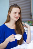 Pretty young blonde woman sitting in the cafe Royalty Free Stock Image