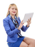 Pretty young blonde woman with a tablet Royalty Free Stock Image