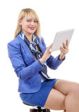 Pretty young blonde woman with a tablet Royalty Free Stock Photography