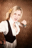 Pretty young blonde woman throwing a punch Stock Image