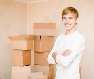 Pretty young boy standing on a background of cardboard Royalty Free Stock Images