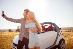 Pretty young boyfriend and girlfriend are going on Royalty Free Stock Photo