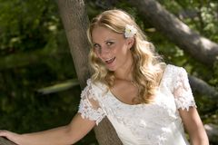 Pretty young bride. A pretty, young, blonde bride smiling outdoors stock photos