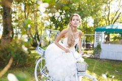 Pretty young bride with bike Stock Photos