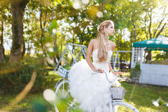 Pretty young bride with bike Royalty Free Stock Image