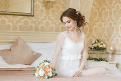 Pretty young Bride. Boudoir morning of the bride. Stock Photo